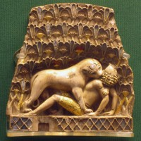 Nimrud_ivory_lion_eating_a_man